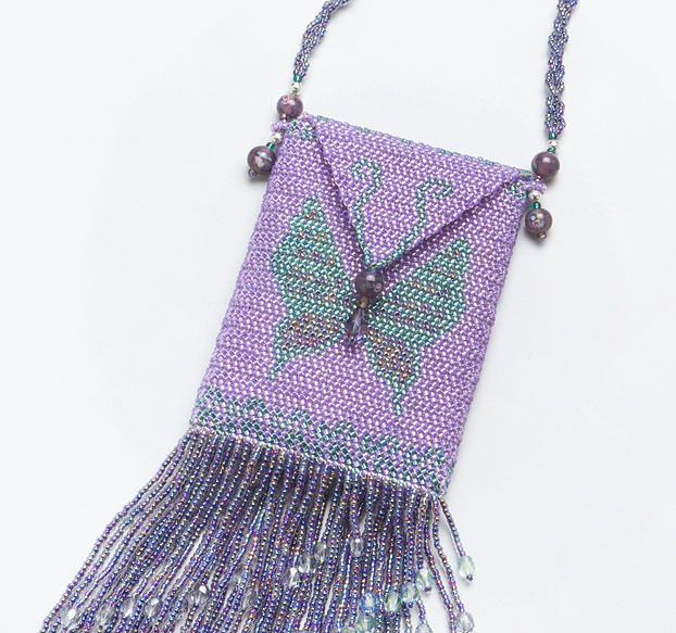 detail of purple butterfly beaded amulet bag