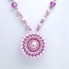 circular flowery pendant necklace