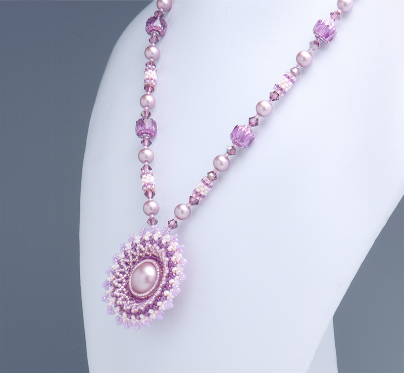 Circular Flowery Pendant Necklace: closeup of the rose pink necklace