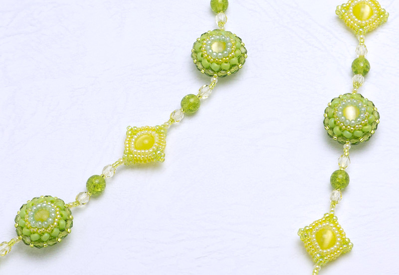 Puffy Circle and Square Necklace: closeup of the yellow necklace