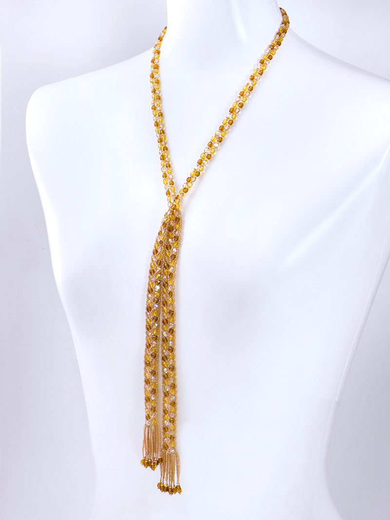 Wearing Brown Lariat. Pass one end through the strap.