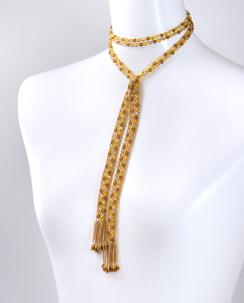 Wearing Brown Lariat. Wrap it around your neck.